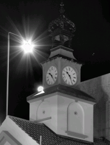 A night time image of the top of a building.
